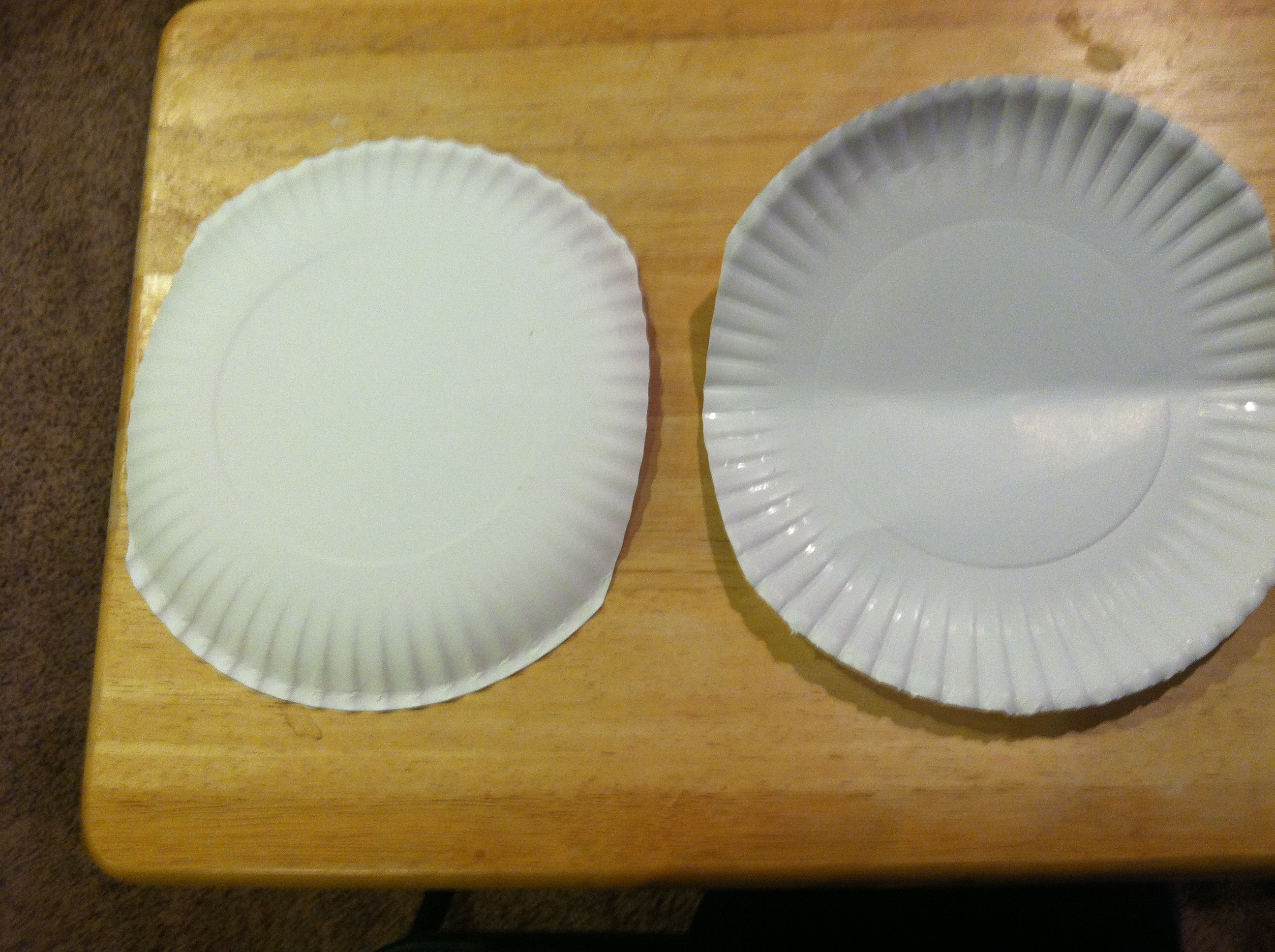 First slightly cut the edges of each paper plate to make them more of an oval shape. Also fold one paper plate in half. & paper plates   Tidbit Times